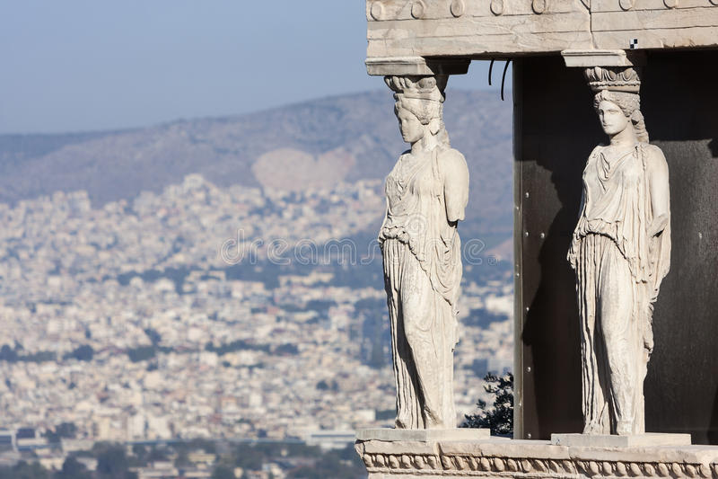 Close up of caryatids in Erechtheion of Erechtheum. A close up of the caryatids in the Erechtheion of Erechtheum, the ancient greek temple in the Acropolis of royalty free stock photo