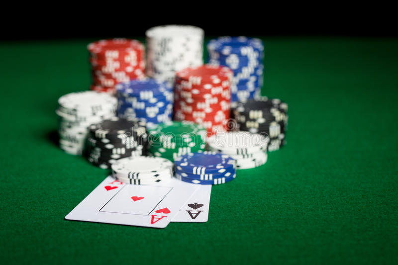 Close up of casino chips and playing cards stock images