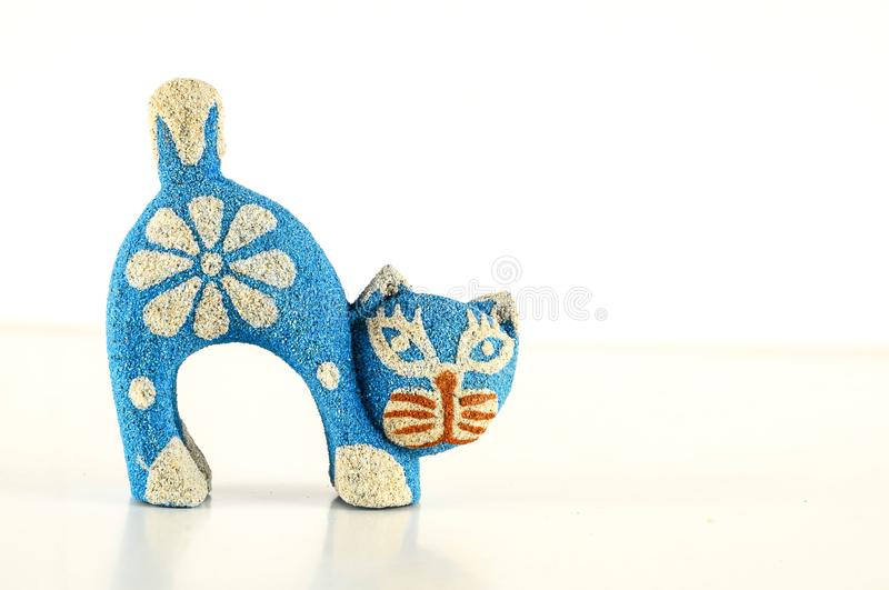 Close-up of cat statuette. Object on a White Background royalty free stock photo