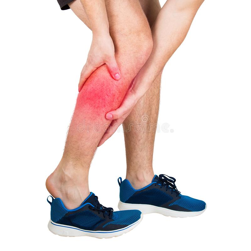 Athlete feeling calf pain from exercise isolated over white background. Sportsman suffering muscle cramp. Close up of caucasian man athletic legs feeling calf royalty free stock photography