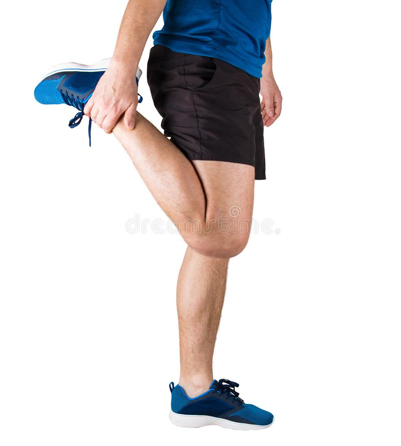 Close up of caucasian sporty man athlete doing warming up exercises and gym before running. Fitness training and muscle stretching royalty free stock photo