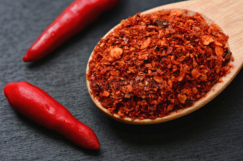 Close up of cayenne pepper in wooden spoon stock photo