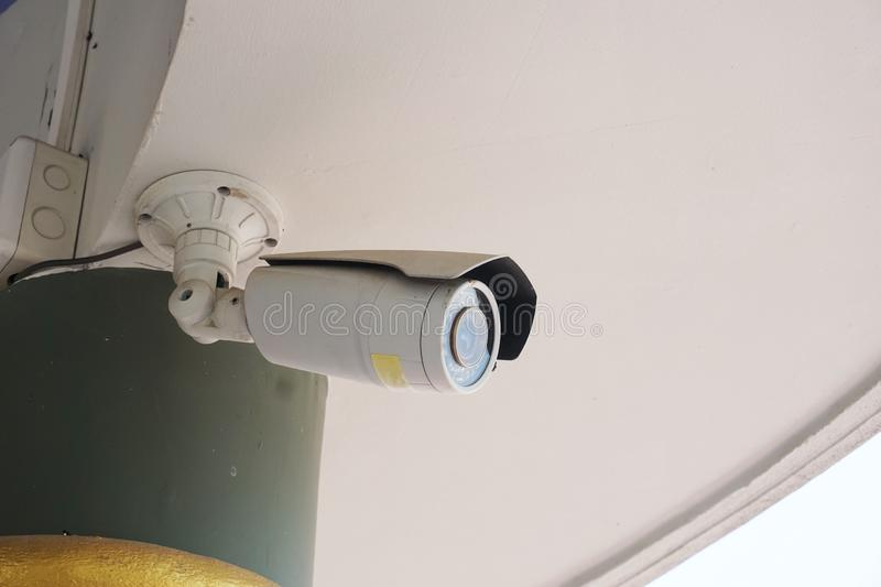 CCTV security camera front of a building in city stock image