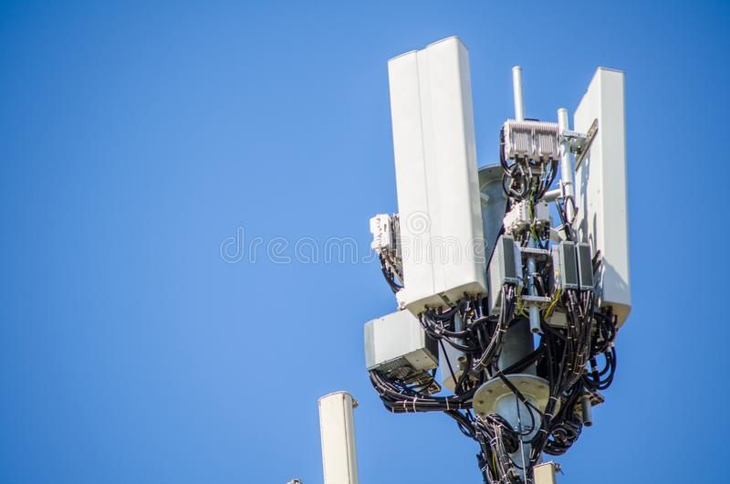 Close up Cellular radio antenna with cable for the telecommunications tower. stock photos