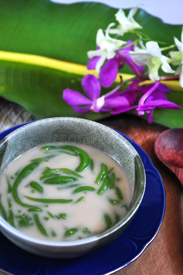 Close up Cendol Bowl Traditional Dessert. Close up Cendol Traditional Dessert with orchid and banana leaf decorated on background royalty free stock photo
