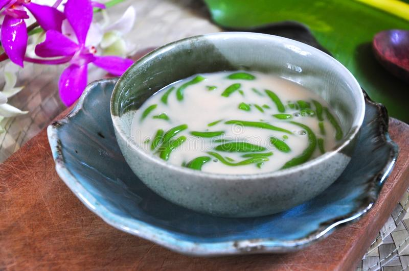 Close up Cendol Bowl on Wooden Board. Close up Cendol bowl put on wooden board royalty free stock image
