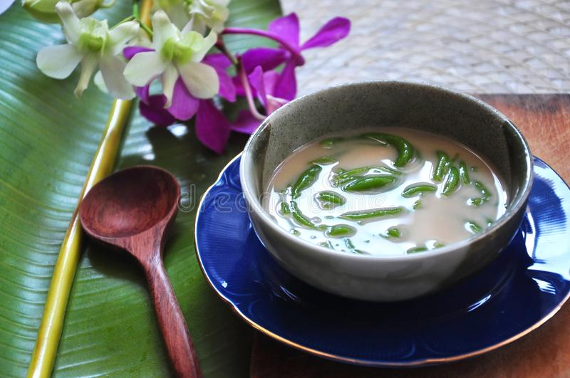 Close up Cendol Traditional Dessert with Wooden Spoon. Close up Cendol bowl traditional dessert with wooden spoon royalty free stock image