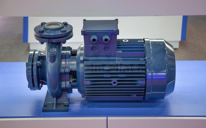 Centrifugal blue pump. Close-up of centrifugal blue pump and motor royalty free stock photos