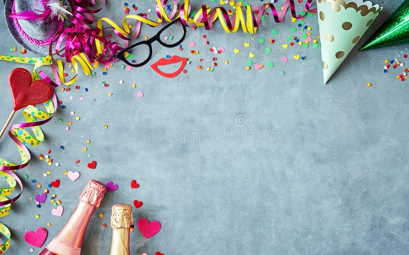 Close up on of chalkboard bordered by party supply royalty free stock image