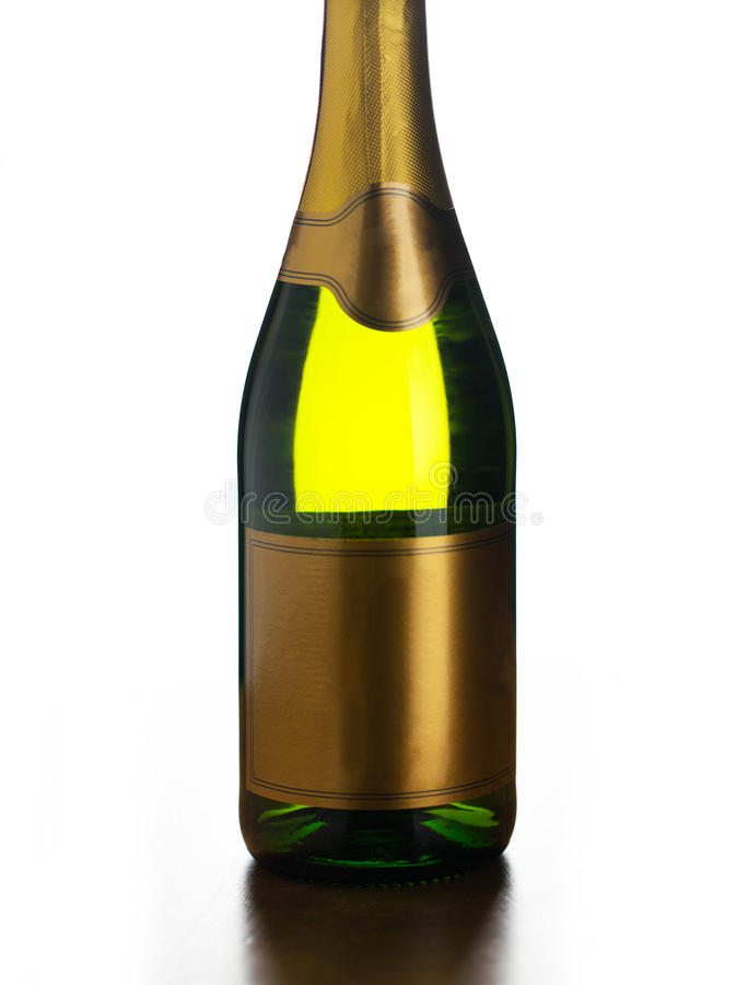 Close up of champagne bottle with blank label. Drink, alcohol, advertisement and holidays concept - close up of bottle of champagne with blank golden label over royalty free stock photo