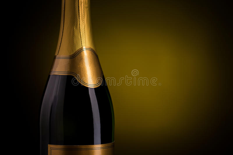 Close up of champagne bottle with blank label. Drink, alcohol, advertisement and holidays concept - close up of bottle of champagne with blank golden label over royalty free stock photos