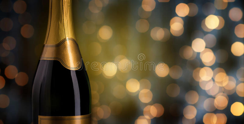 Close up of champagne bottle with blank label. Drink, alcohol, advertisement and holidays concept - close up of bottle of champagne with blank golden label over stock images