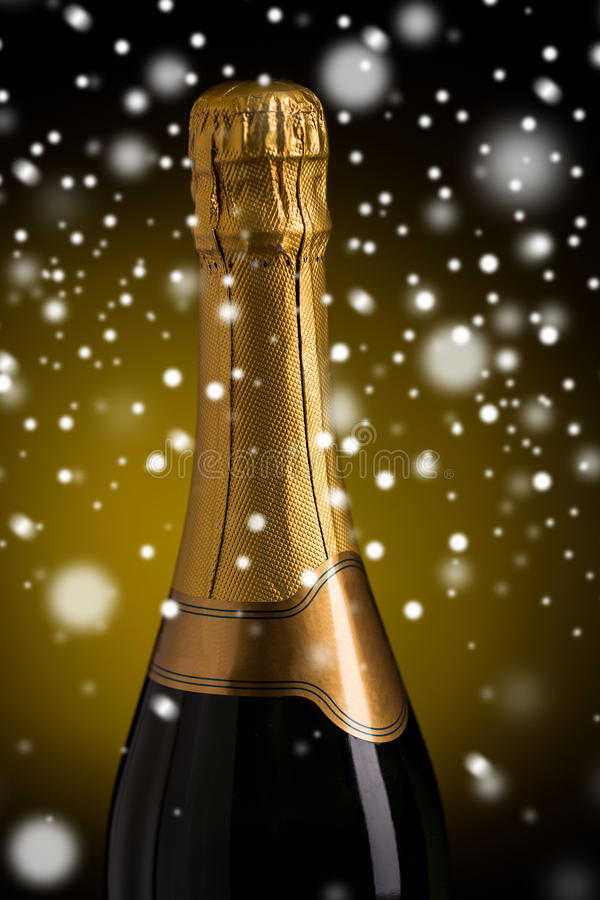Close up of champagne bottle with golden label. Drink, alcohol, christmas, new year and winter holidays concep - close up of bottle of champagne with blank stock image