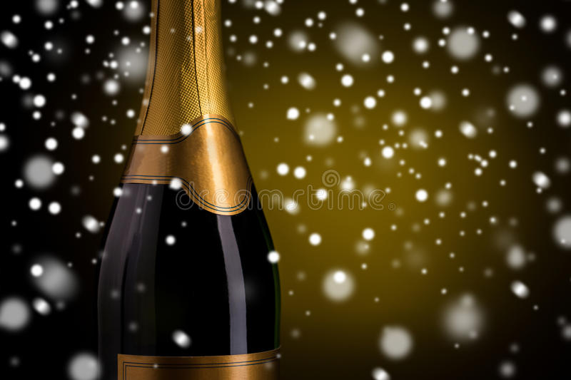 Close up of champagne bottle with golden label. Drink, alcohol, christmas, new year and winter holidays concept - close up of bottle of champagne with blank stock photo