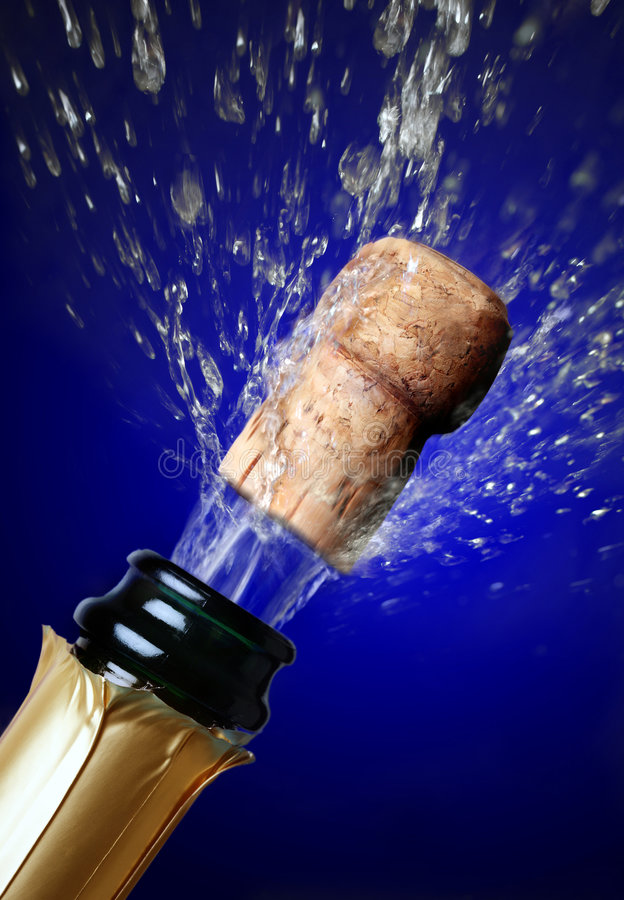 Close up of champagne cork popping royalty free stock image