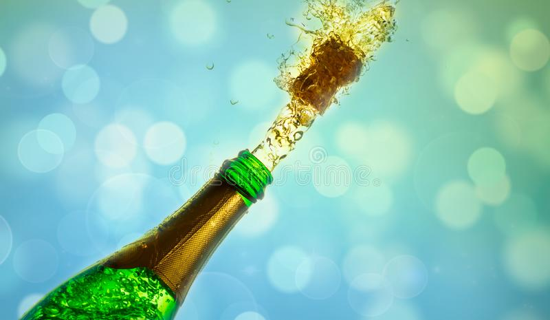 Close up of champagne cork popping on bokeh background stock photography
