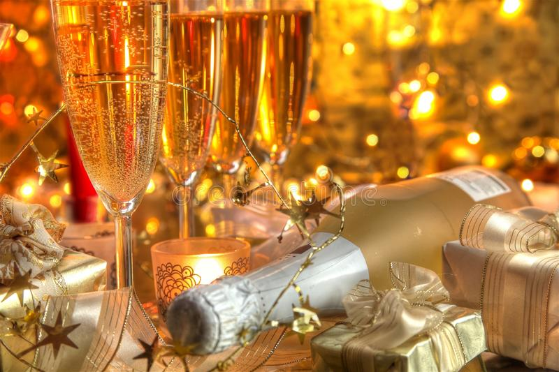 Close-up of champagne in glasses and gifts royalty free stock images