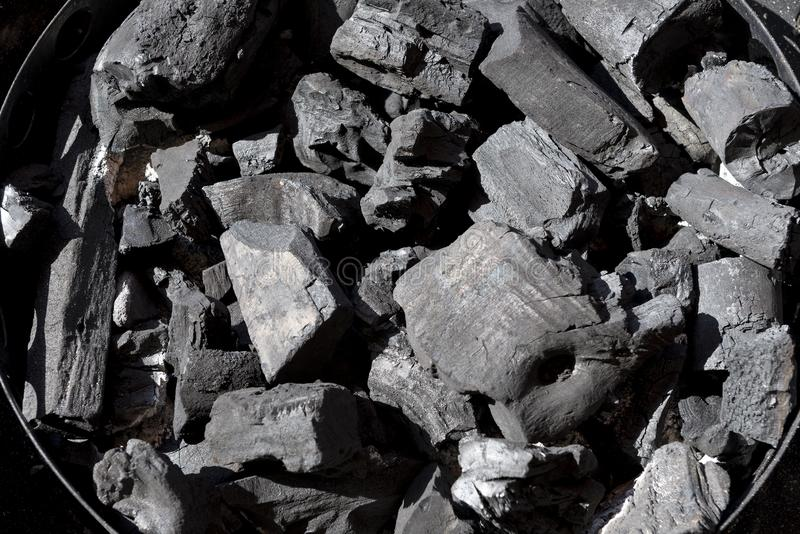 Charcoal in Chimney for ignition stock images
