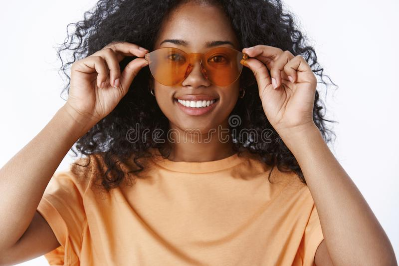 Close-up charming smiling african american girl afro hairstyle checking sunglasses bying new pair glasses get ready. Tourist travel vacation smiling delighted stock photos