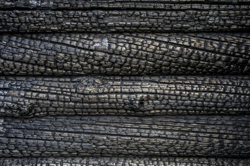 Charred wall of a blockhouse. Close up of a charred wall of a blockhouse stock photography