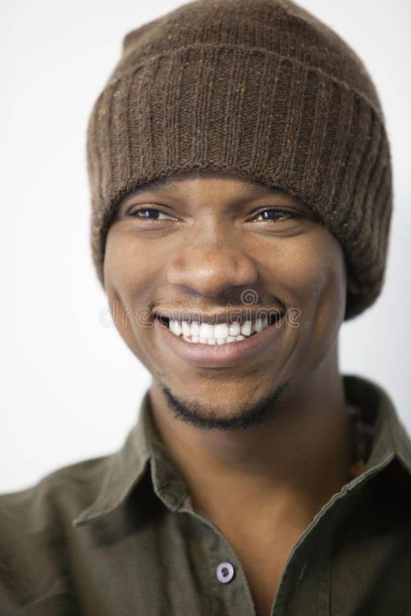 Close-up of a cheerful African American man wearing knit hat royalty free stock image