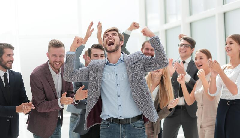 Cheerful employees congratulating a colleague on the promotion royalty free stock photography