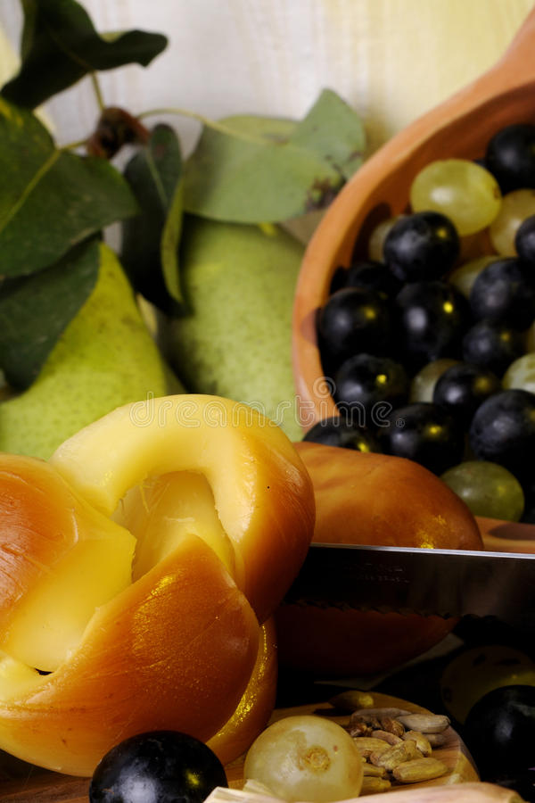 Close-up with cheese and fruits stock image
