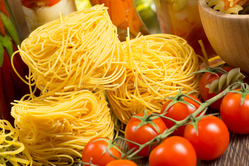 Close-up of cherry tomatoes and pasta stock images