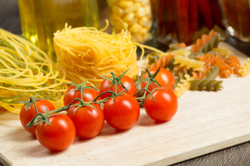 Close-up of cherry tomatoes and pasta royalty free stock photos