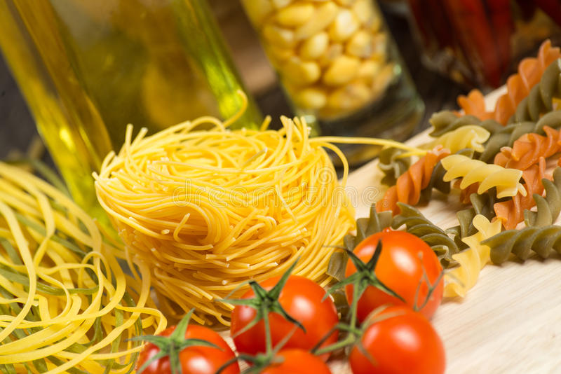 Close-up of cherry tomatoes and pasta royalty free stock images
