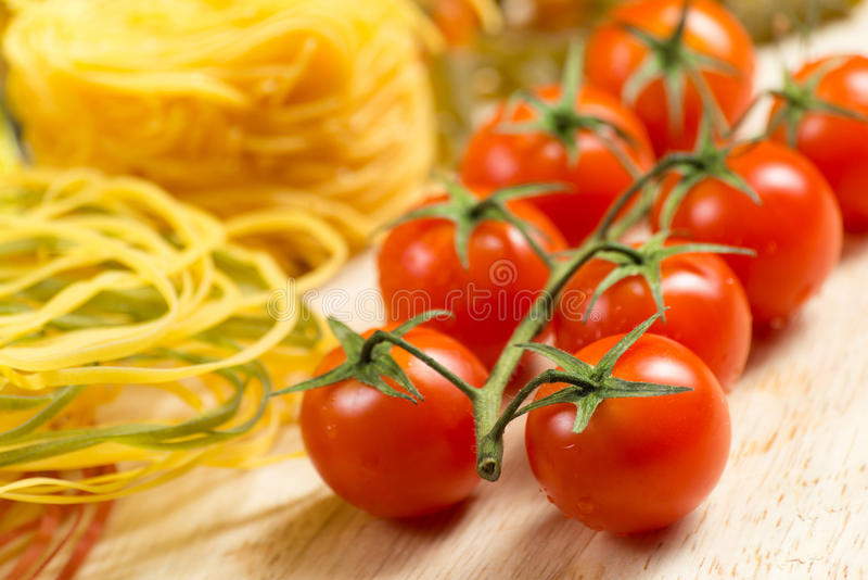Close-up of cherry tomatoes and pasta stock photography