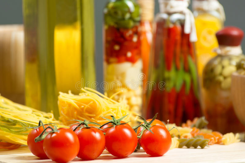 Close-up of cherry tomatoes and pasta royalty free stock image