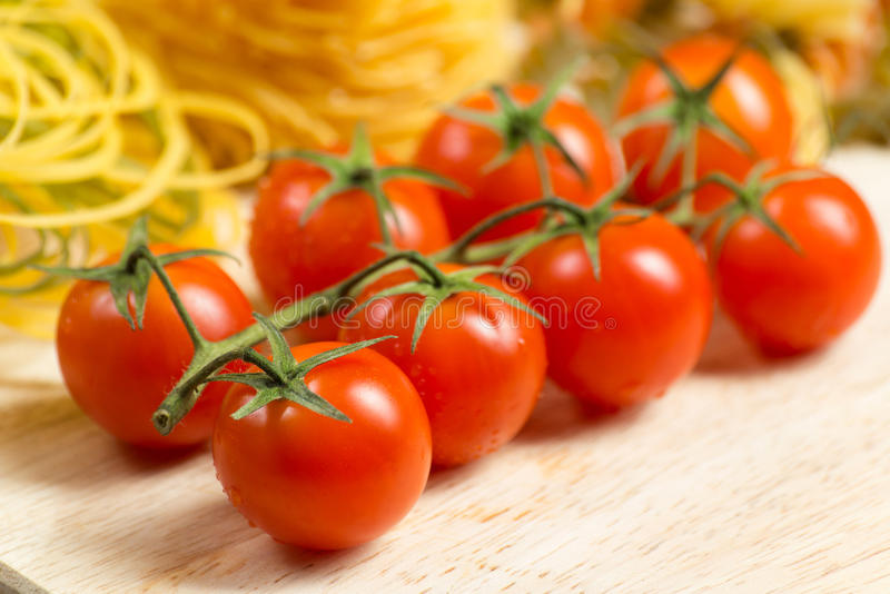 Close-up of cherry tomatoes and pasta royalty free stock photo