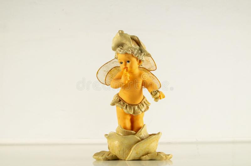 Close-up of child angel statuette. Object on a White Background stock photo