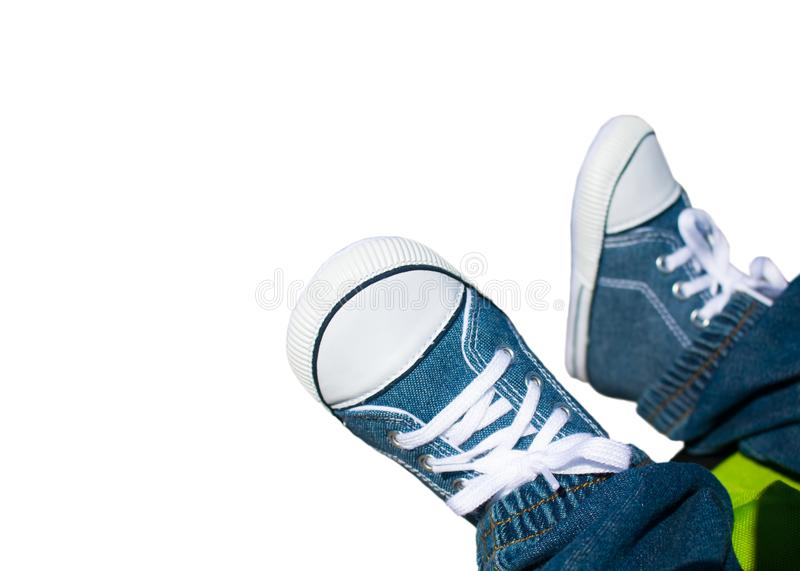 Close-up on child feet with sneakers. Feet of a baby sneakers, selective focus royalty free stock photos