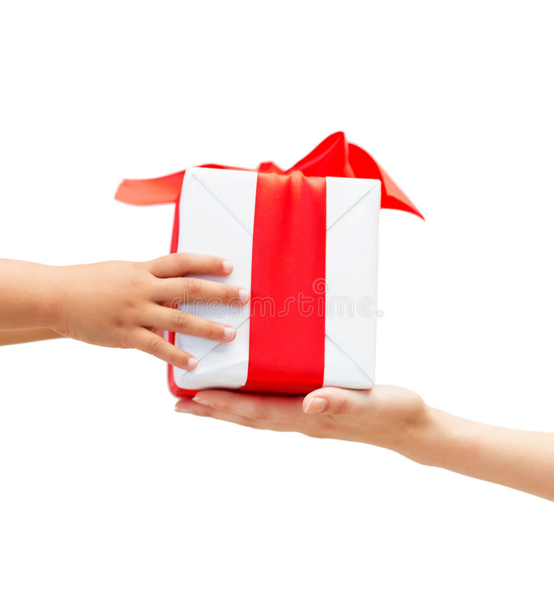 Close up of child and mother hands with gift box stock photos