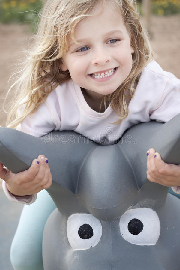 Girl smiling at the playground royalty free stock photo