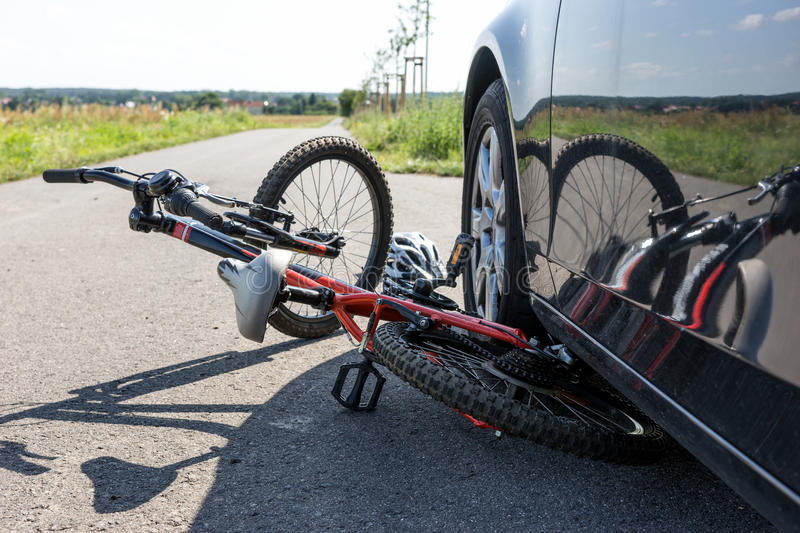 Close Up of a children`s bicycle accident on the street. Close Up of a children`s bicycle accident on the city street stock image