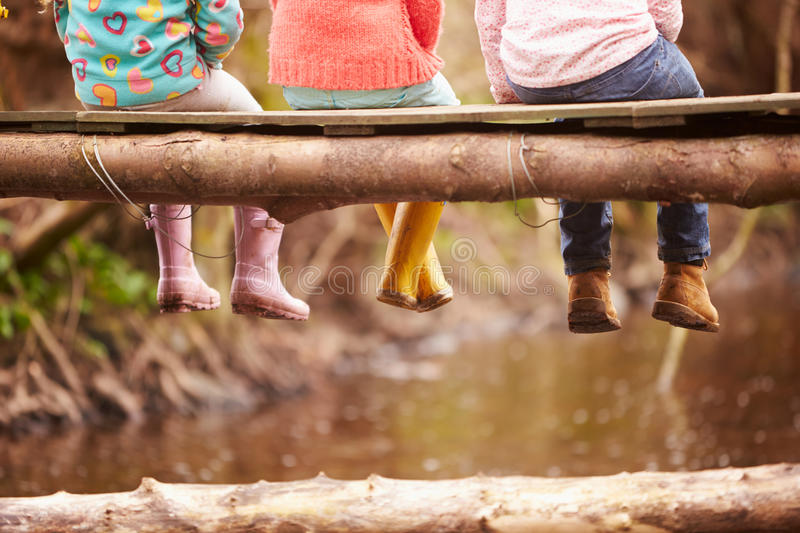 Download Close Up Of Children's Feet Dangling From Wooden Bridge Stock Image - Image of exploring, outdoor: 59780065