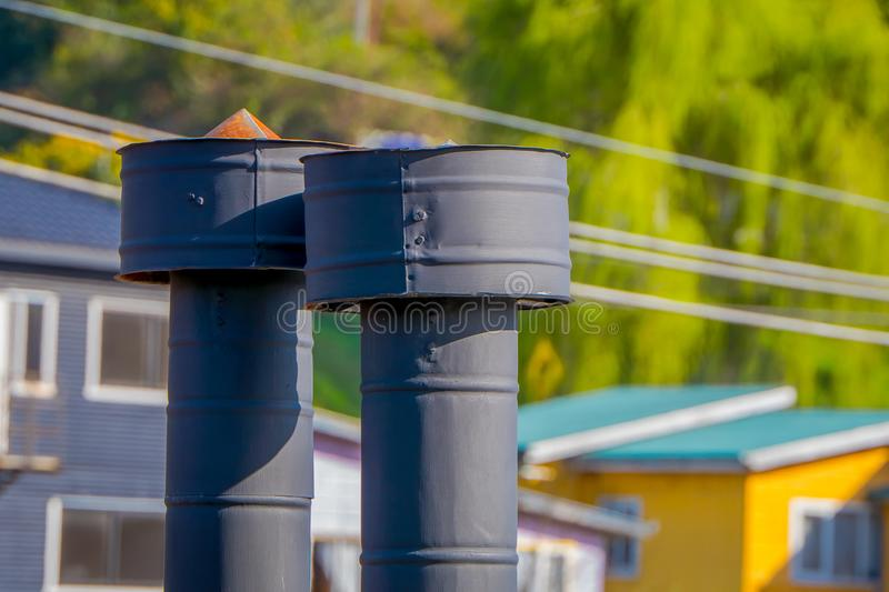 Close up of chimney in the rooftop located in Castro, Chiloe Island. In Chile royalty free stock photo
