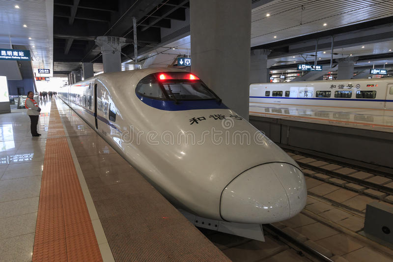 Close up of a Chinese fast train inside the newly opened high speed train station in Kunming. The new fast train station links Ku. Kunming, China - March 29 royalty free stock image