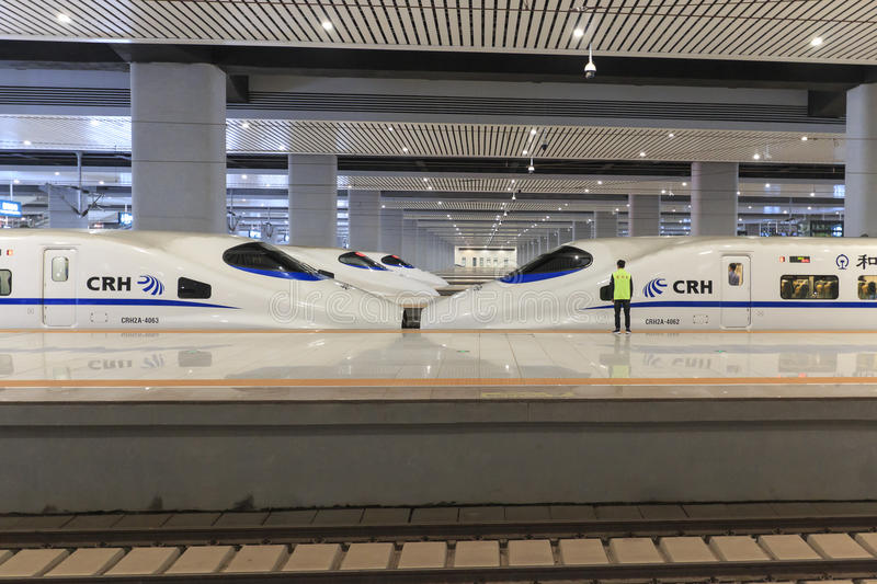 Close up of a Chinese fast train inside the newly opened high speed train station in Kunming. The new fast train station links Kun. Kunming, China - March 29 stock photos