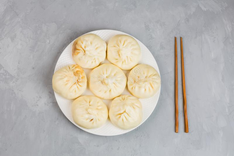 Close up of Chinese steamed dumplings on gray concrete background. Flat lay, top view, overhead, mockup, template. Asian food stock image