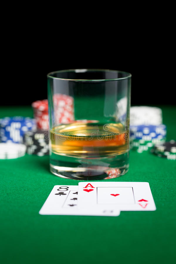 Close up of chips, cards and whisky glass on table royalty free stock photos
