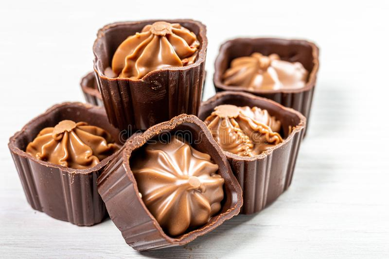 Close-up of chocolate candies with nut cream royalty free stock photo