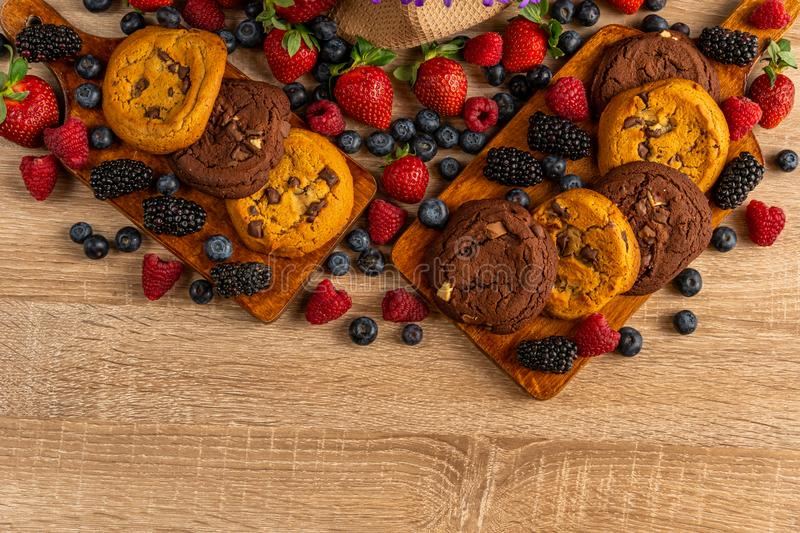 Close up of chocolate cookies with forest fruits with copyspace below royalty free stock images