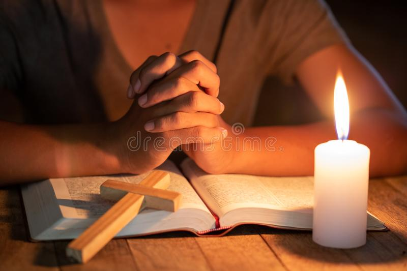 Close up of Christian boys  are reading and study bible In the room and lit candles to light, Religious concepts stock photos