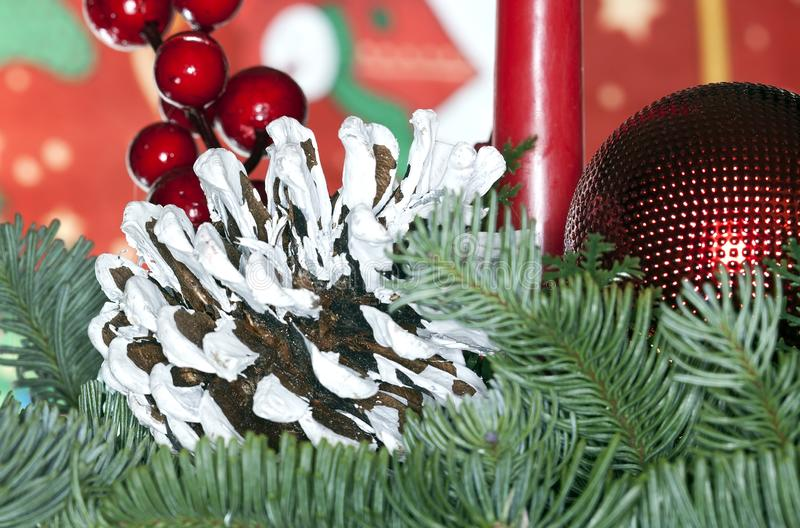 Close up christmas decoration. With white painted cone and ball royalty free stock photos