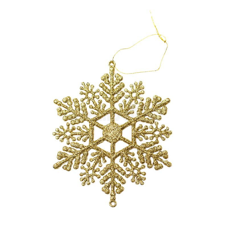 Close up christmas decoration golden snowflake isolated on white background. Holiday decor concept. Overhead stock image