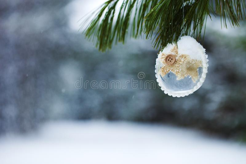 Close-up of Christmas decoration hanging on fir tree branch stock photography